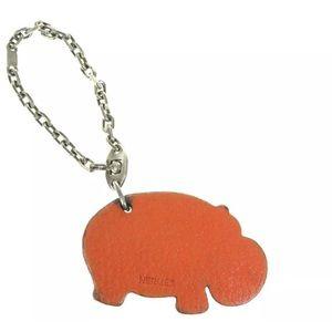 authentic HERMÈS burnt orange HIPPO bag charm $750